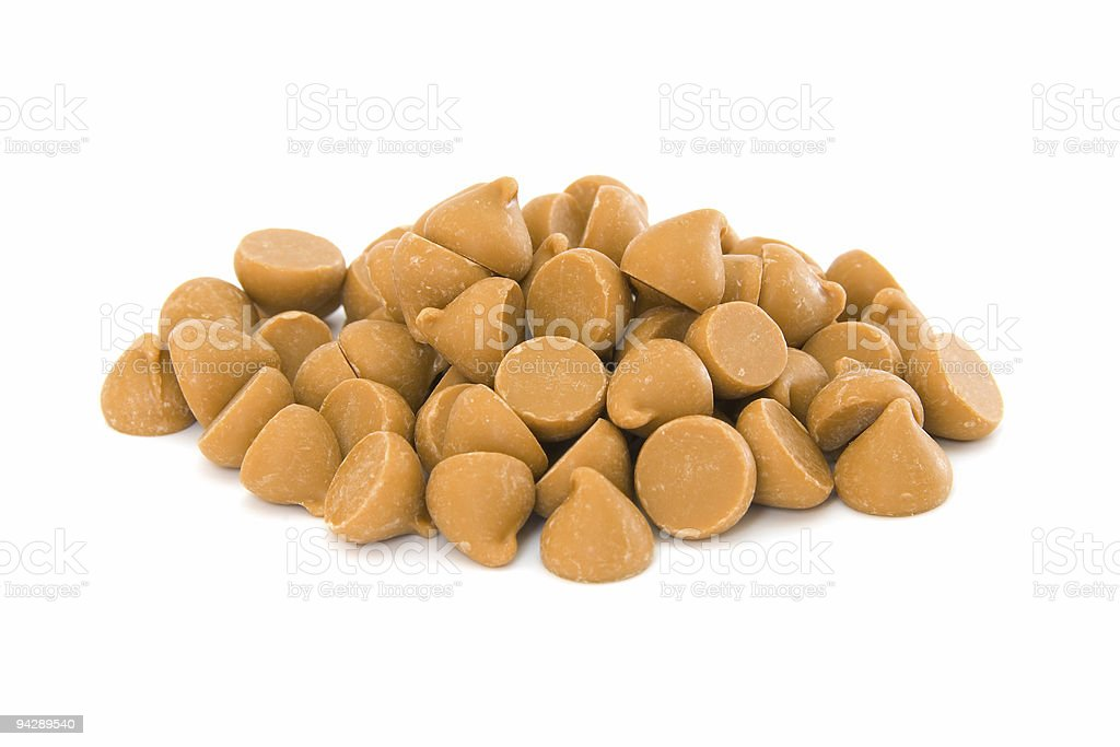 Pile of butterscotch chips on white stock photo