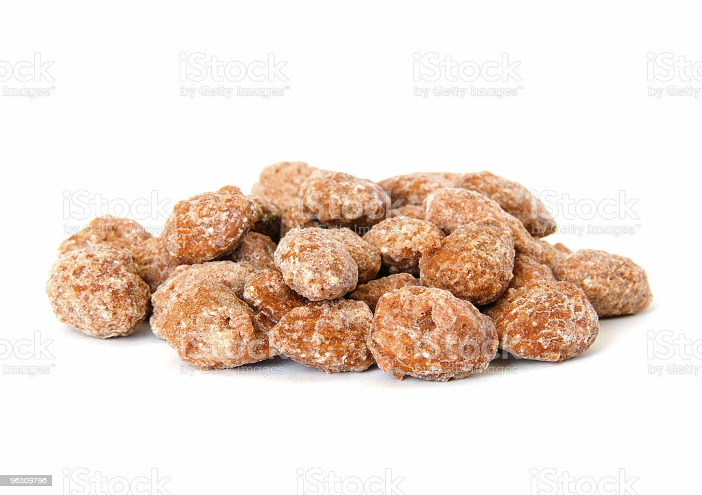 Pile of candied rosted almonds on white stock photo