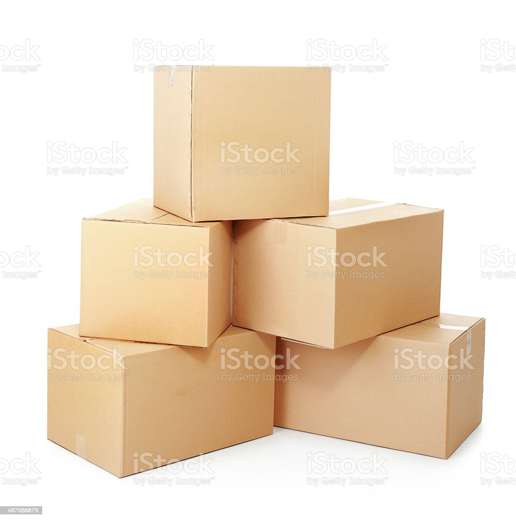 Pile of cardboard boxes stacked in increasing size stock photo