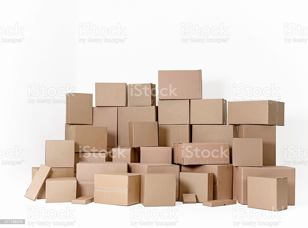 Pile of cardboard boxes stacked one on another, white background stock photo