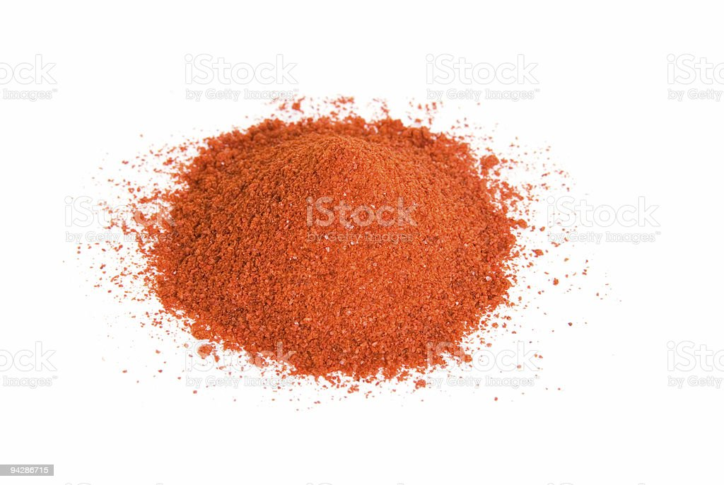 Pile of cayenne pepper isolated on white royalty-free stock photo