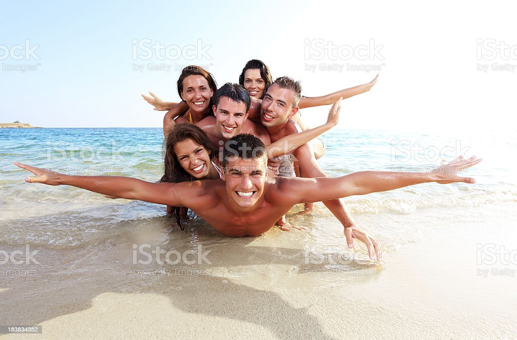 Pile of cheerful people on the beach. royalty-free stock photo