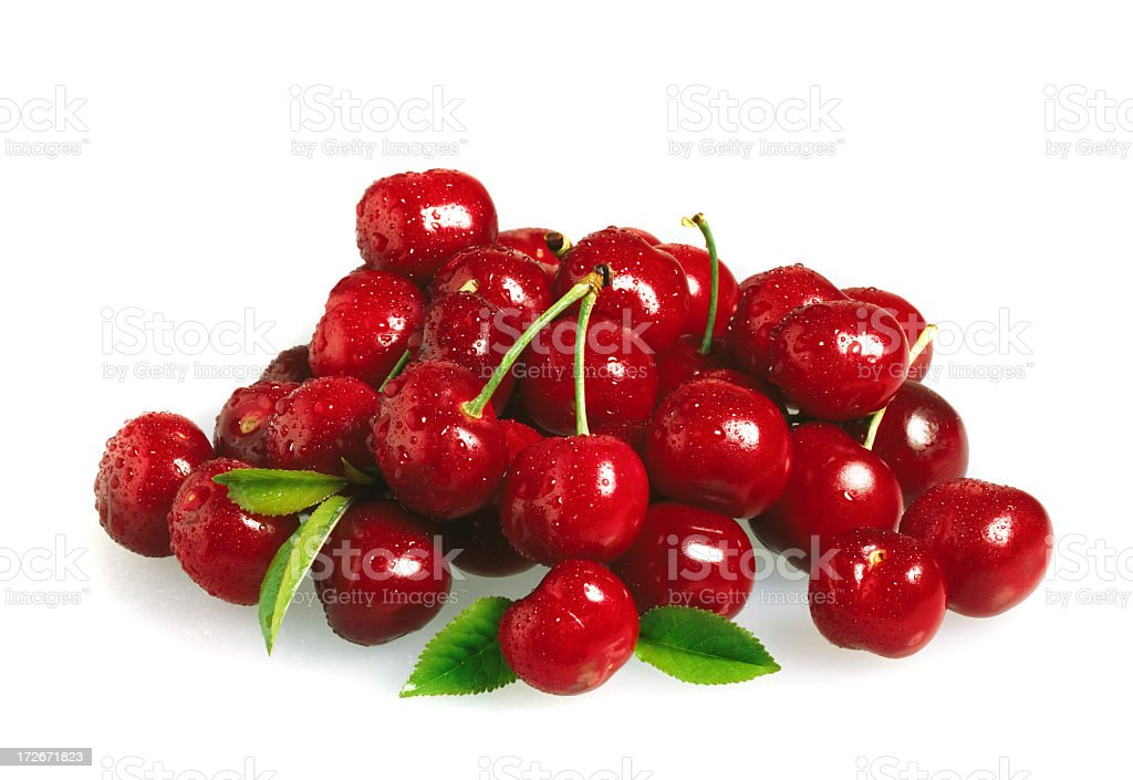 Pile of cherries with stems on a white background stock photo