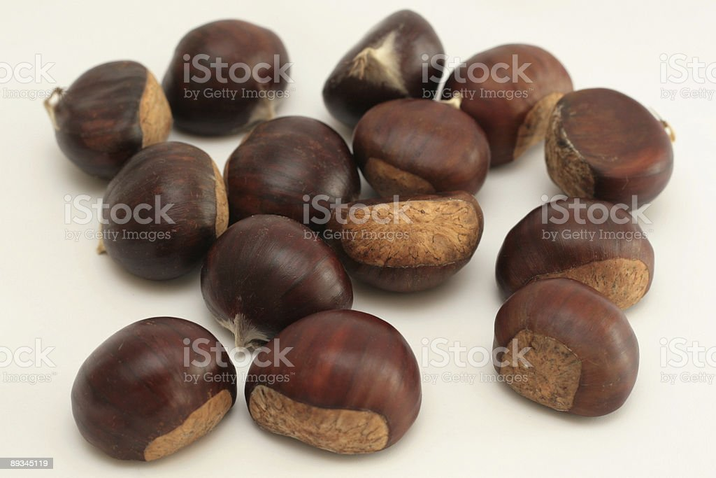 Pile of chestnuts on white royalty-free stock photo