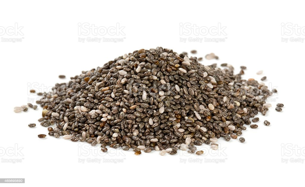 Pile of chia seeds on white surface stock photo