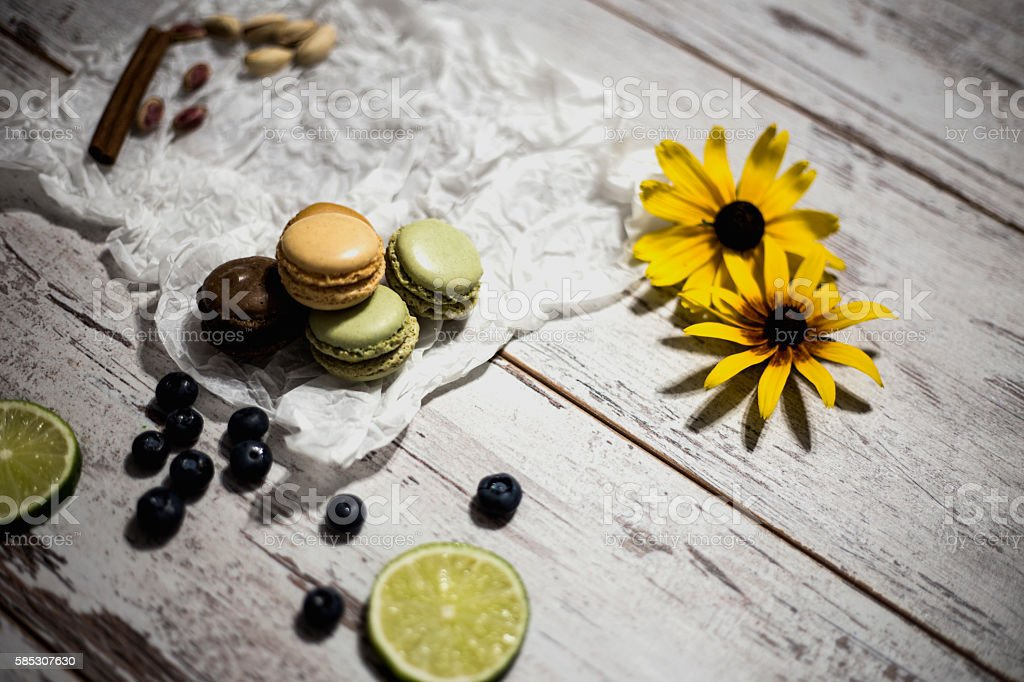 Pile of chocolate macaroons and blueberry on the wooden table stock photo