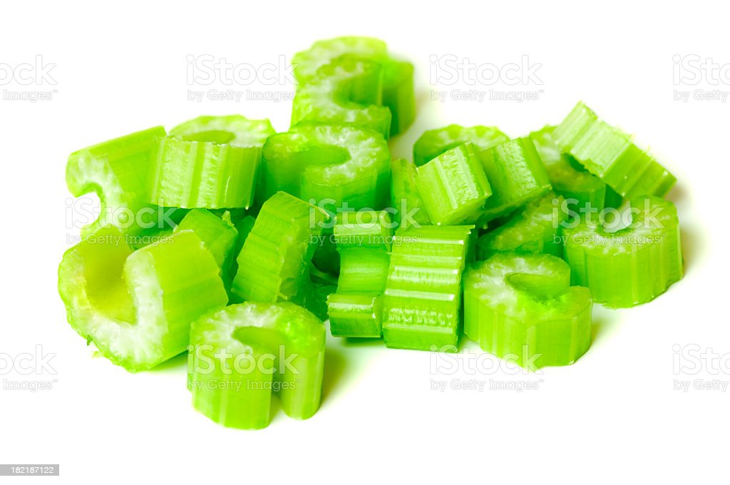 Pile of chopped celery isolated on white background stock photo