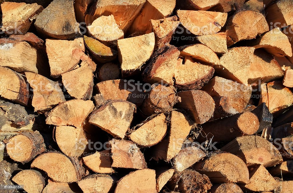 Pile of chopped fire wood prepared for winter. stock photo