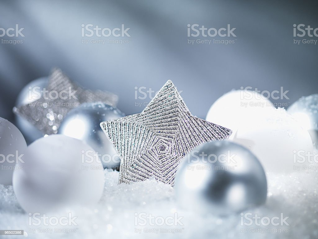 Pile of Christmas ornaments in snow royalty-free stock photo