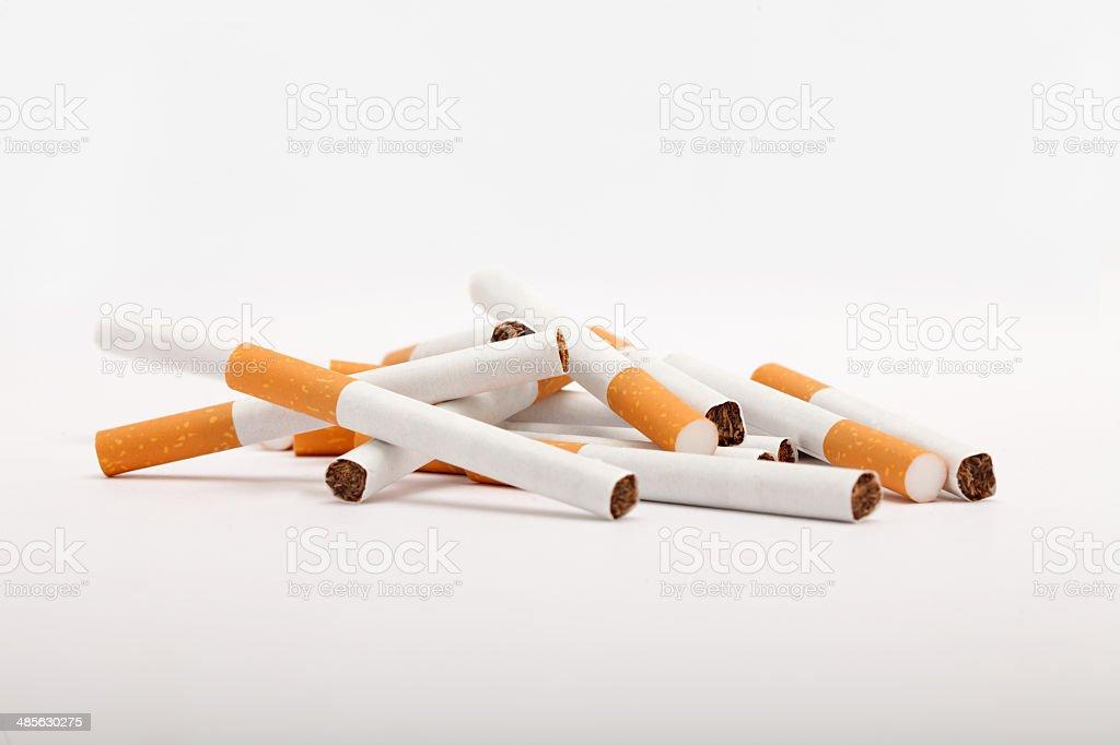 Pile of cigarettes stock photo
