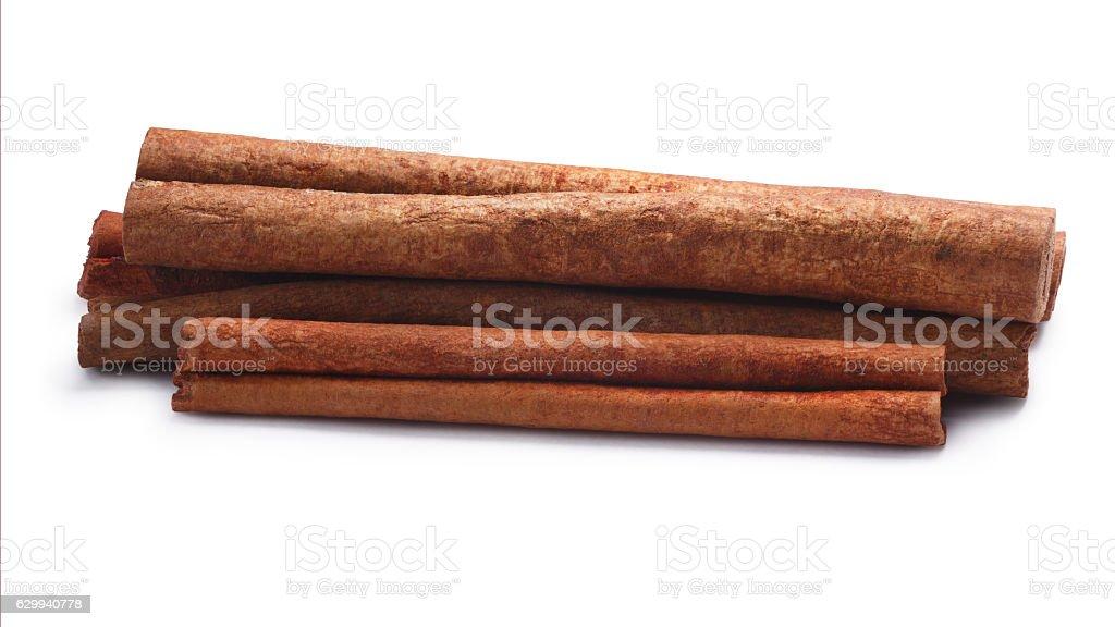Pile of cinnamon sticks, paths stock photo