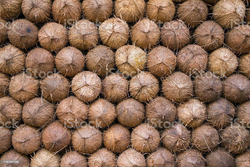Pile of coconuts background. Food market in India royalty-free stock photo