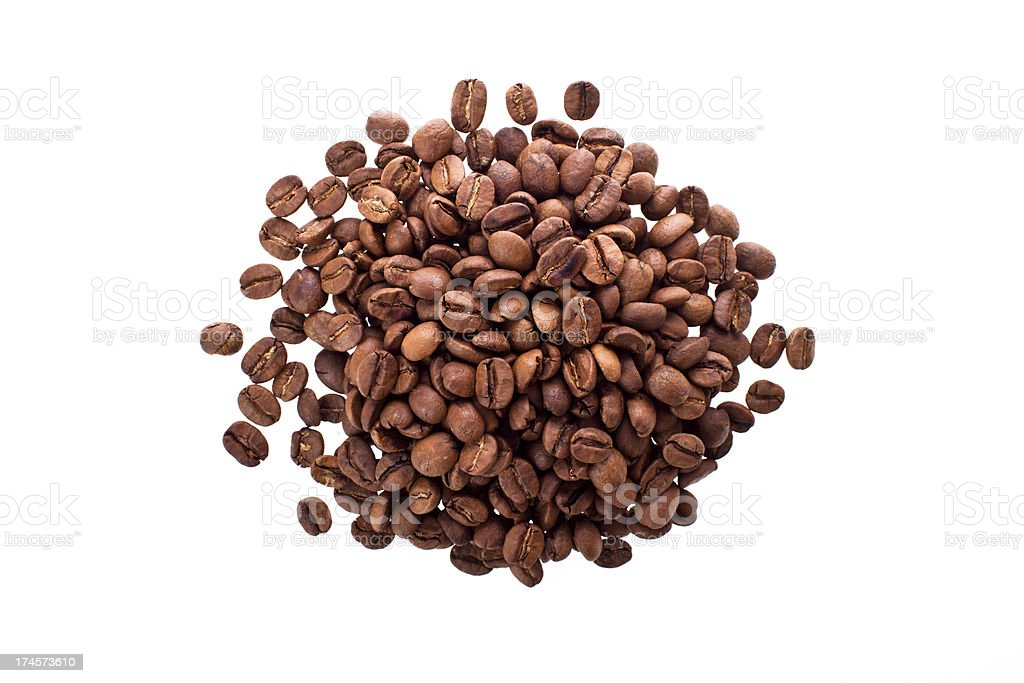 pile of coffee beans on white background. royalty-free stock photo