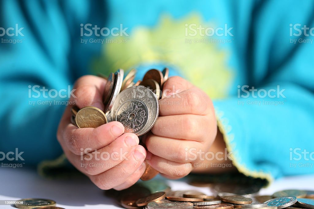 A pile of coins overflowing out of a pair of hands royalty-free stock photo