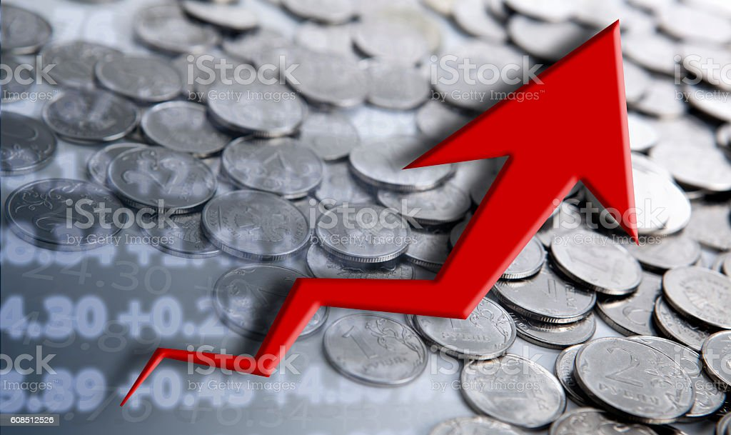 pile of coins with digits and diagram stock photo