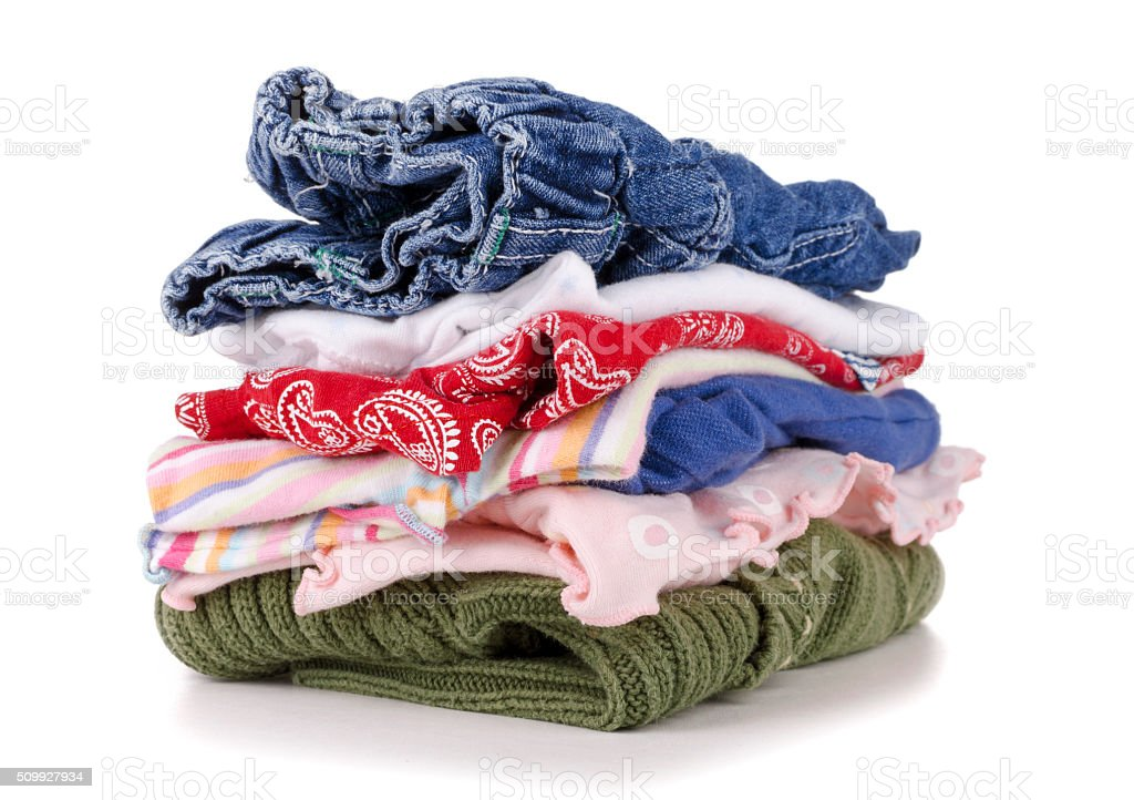 pile of colorful children's clothing on a white stock photo