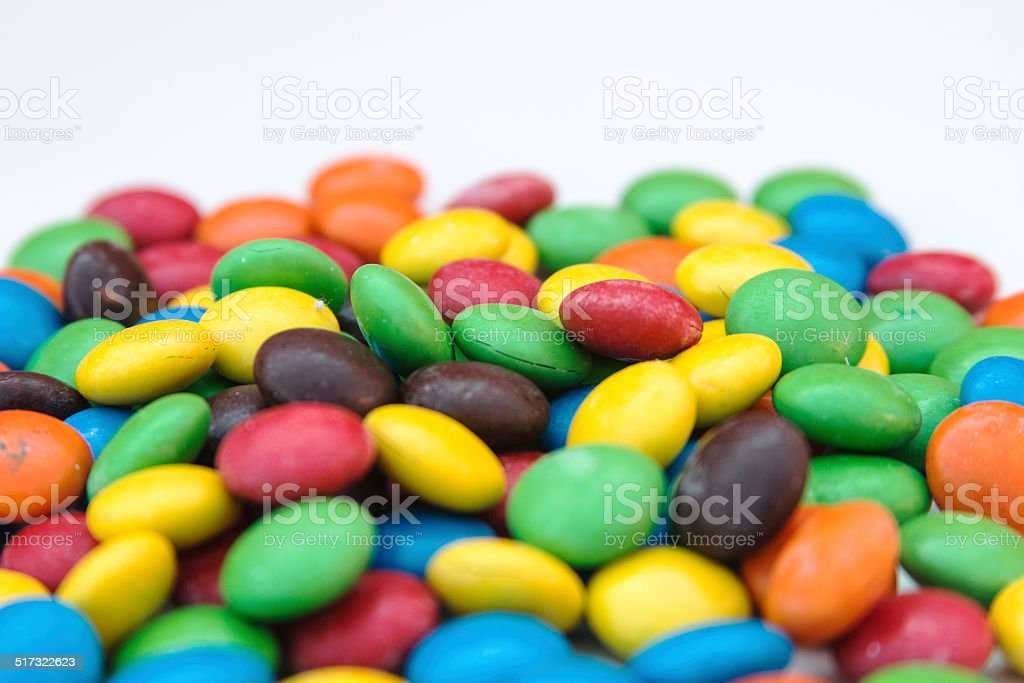 Pile of colorful chocolate coated candy stock photo