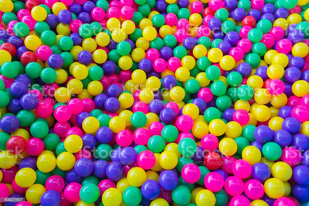 Pile of colorful little balls for children to play around stock photo