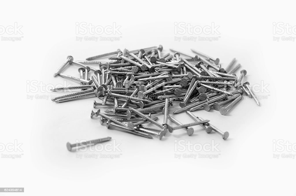 Pile of Construction Nails on a White Background royalty-free stock photo