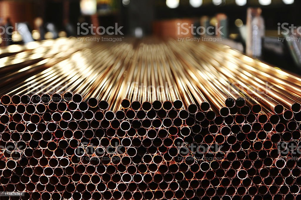 Pile of copper pipes stock photo