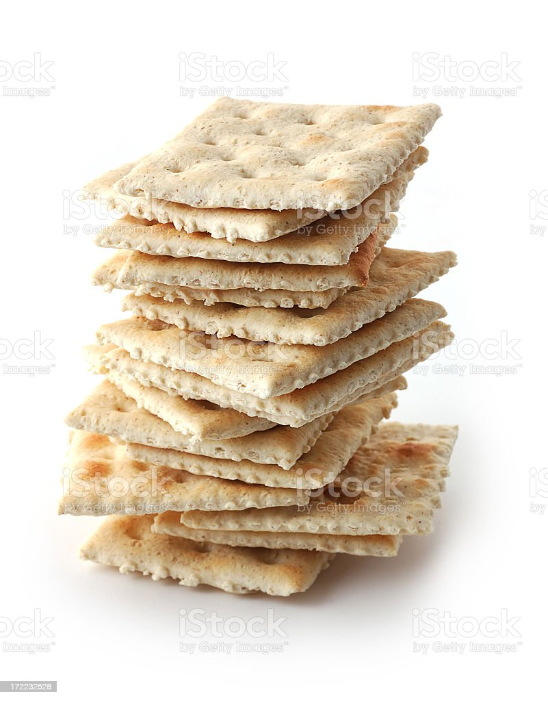 A pile of crackers on white background stock photo