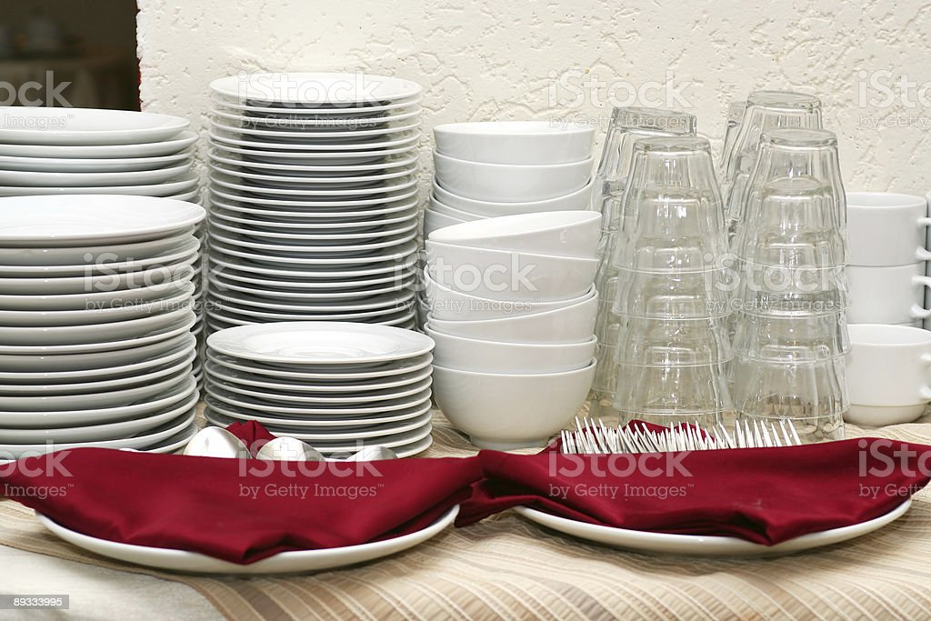 Pile of crockery (kitchenware) stock photo