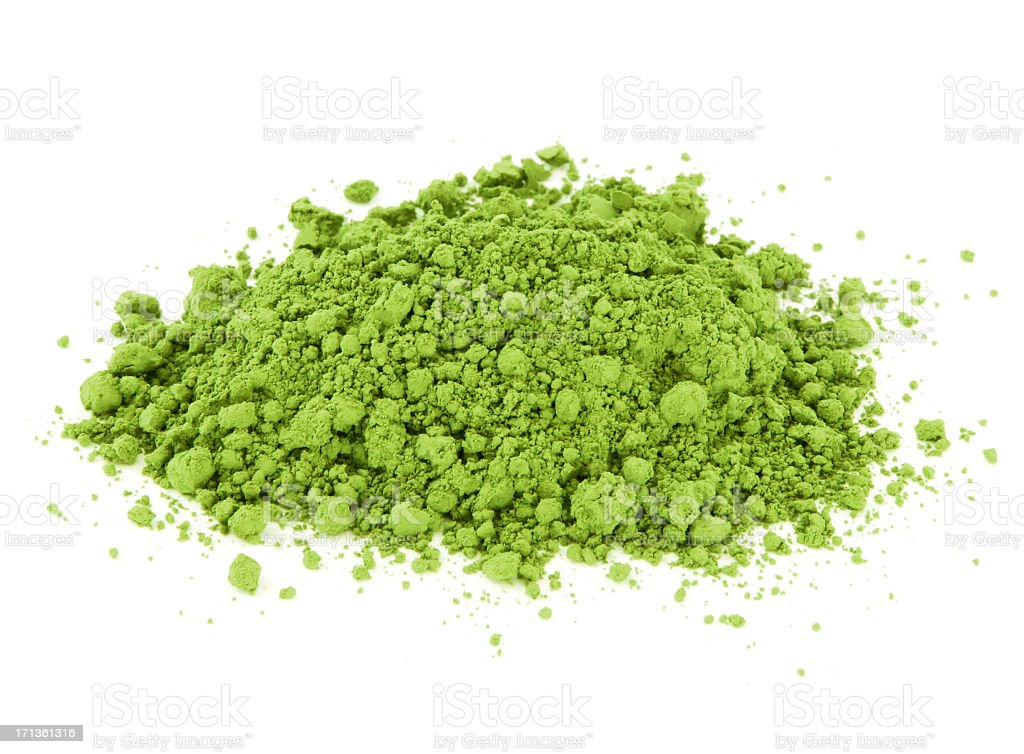 Pile of crumbled green Matcha tea on white background stock photo