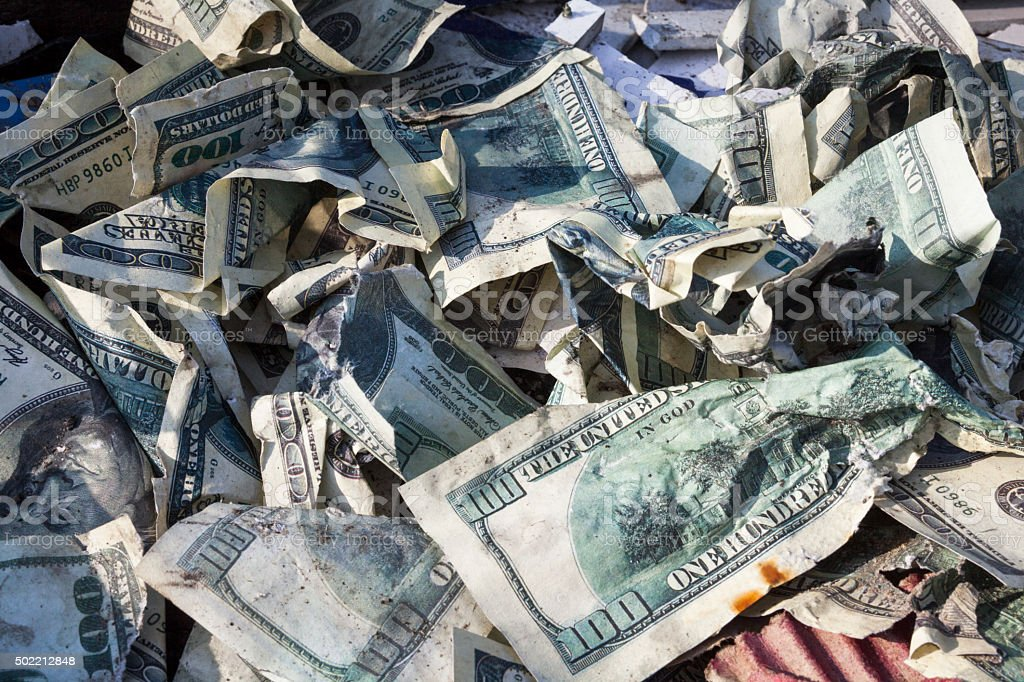 Pile of crumpled dollars stock photo
