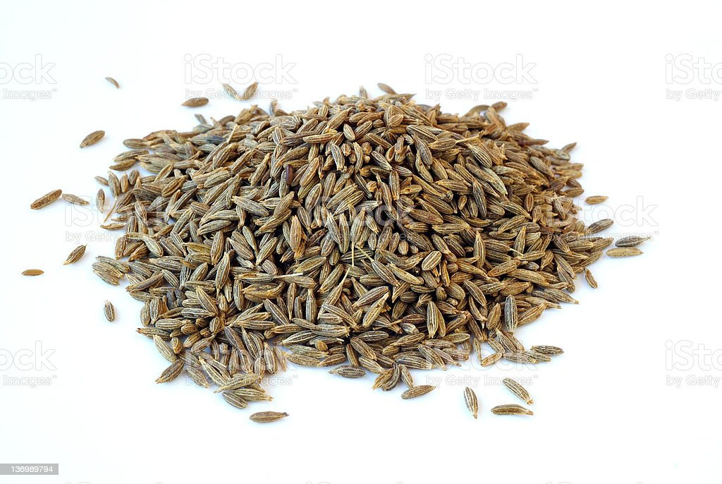 A pile of cumin on a white background stock photo