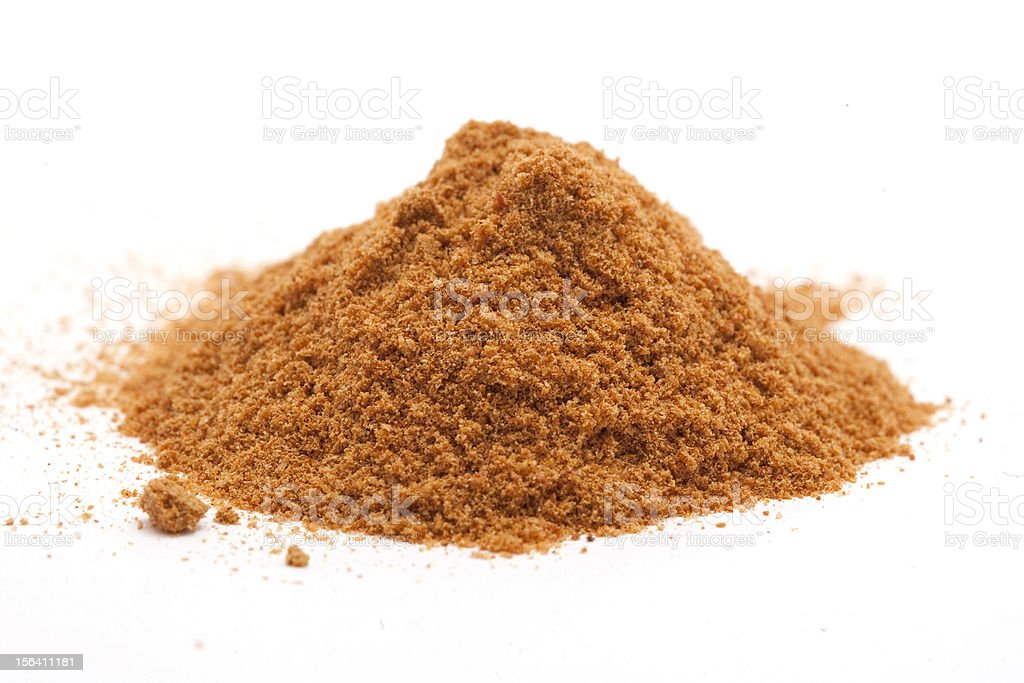 pile of curry powder isolated on white stock photo