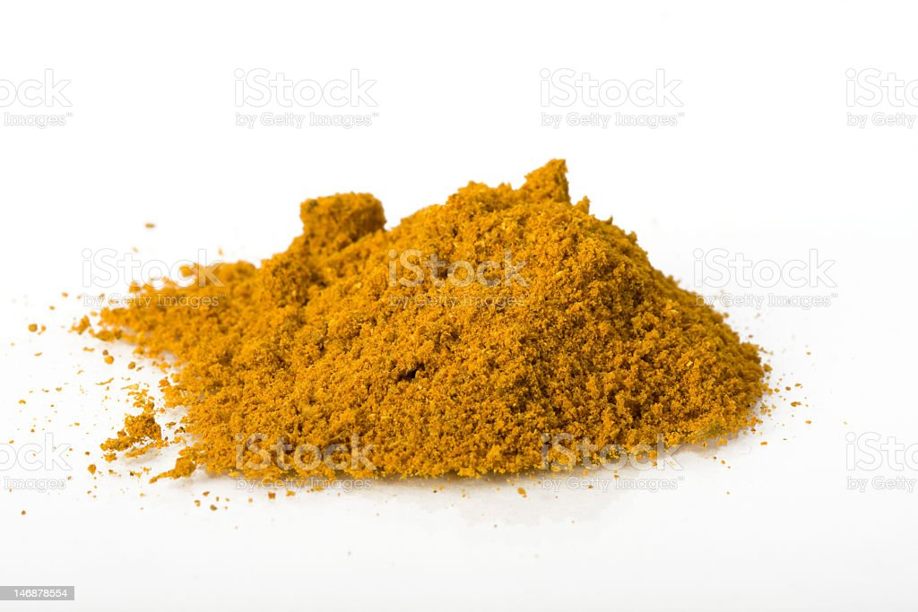 Pile of curry powder on white background royalty-free stock photo