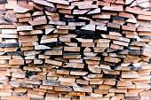 pile of cut wooden planks stacked