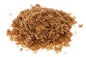 Pile of demerara sugar colored brown with molasses