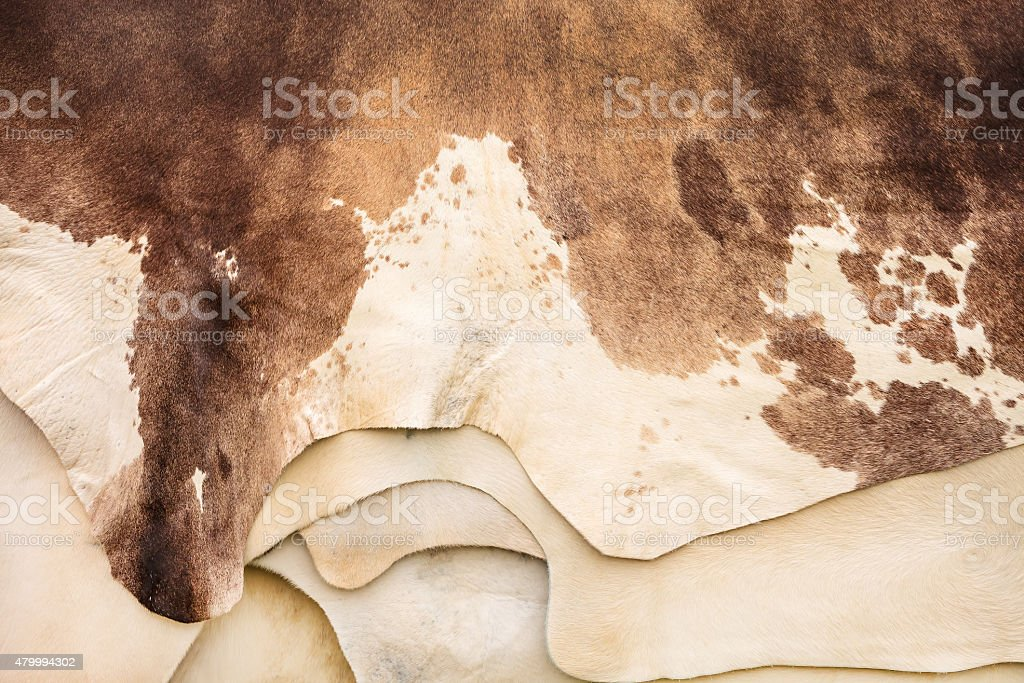 Pile of different cow hides stock photo