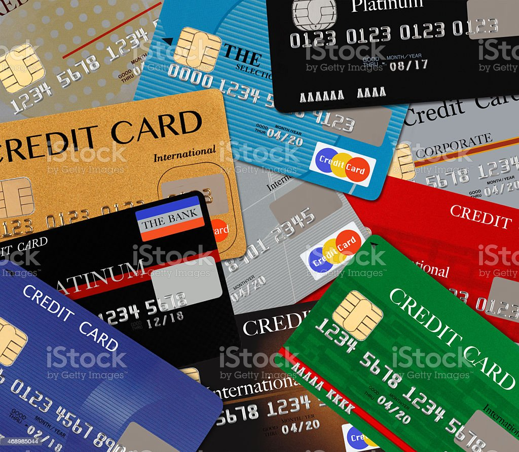 Pile of different multicolored credit cards background stock photo