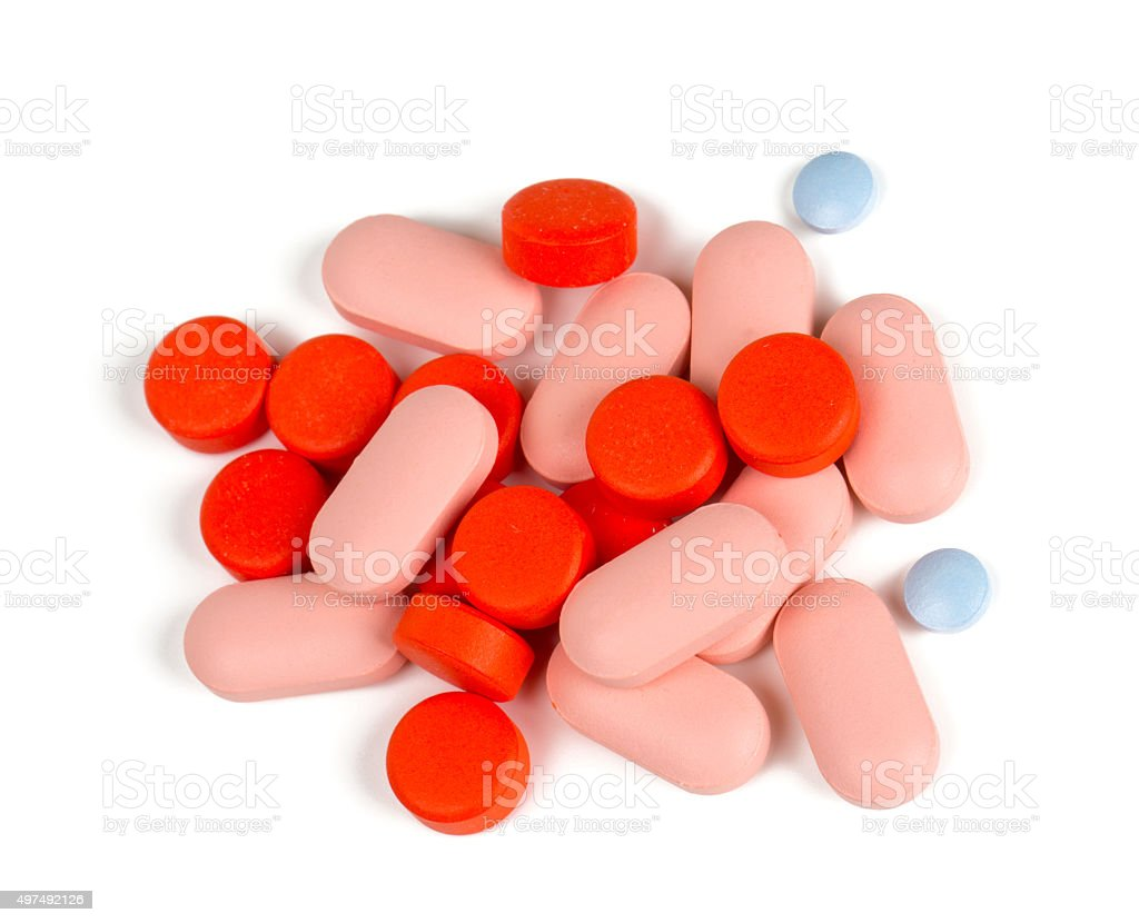 pile of different pills isolated on white stock photo
