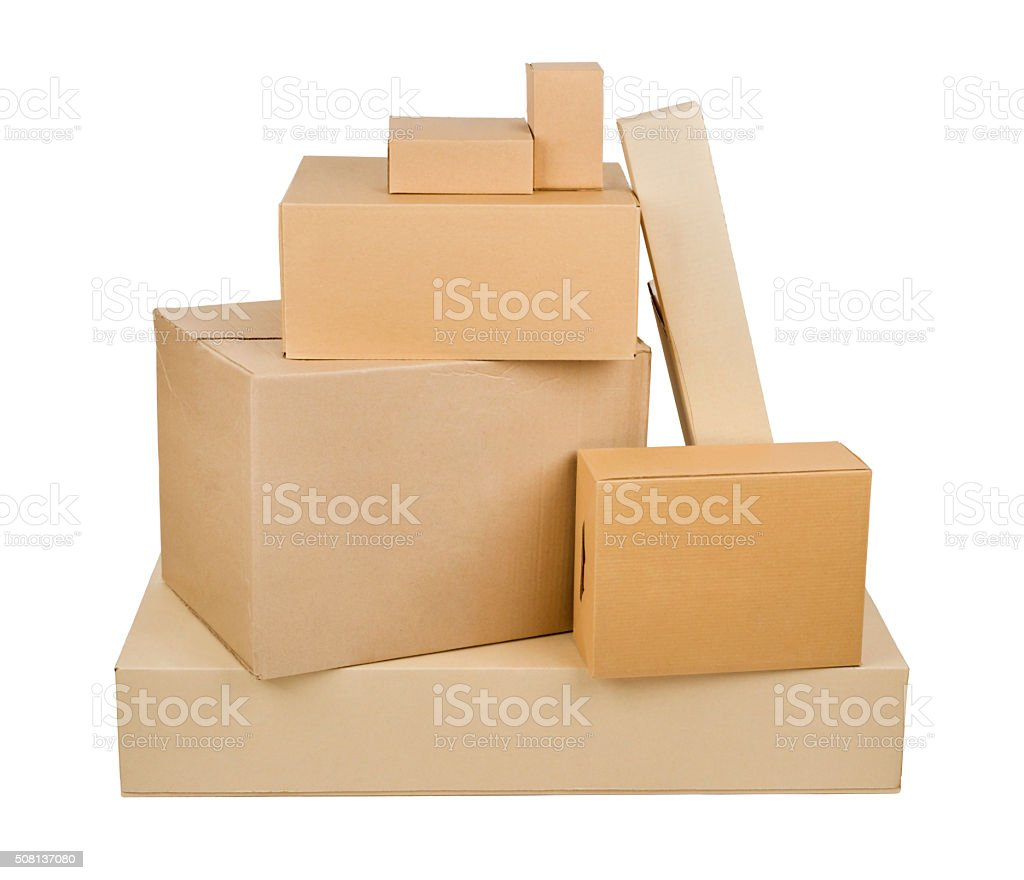 Pile of different size cardboard boxes isolated on white background stock photo