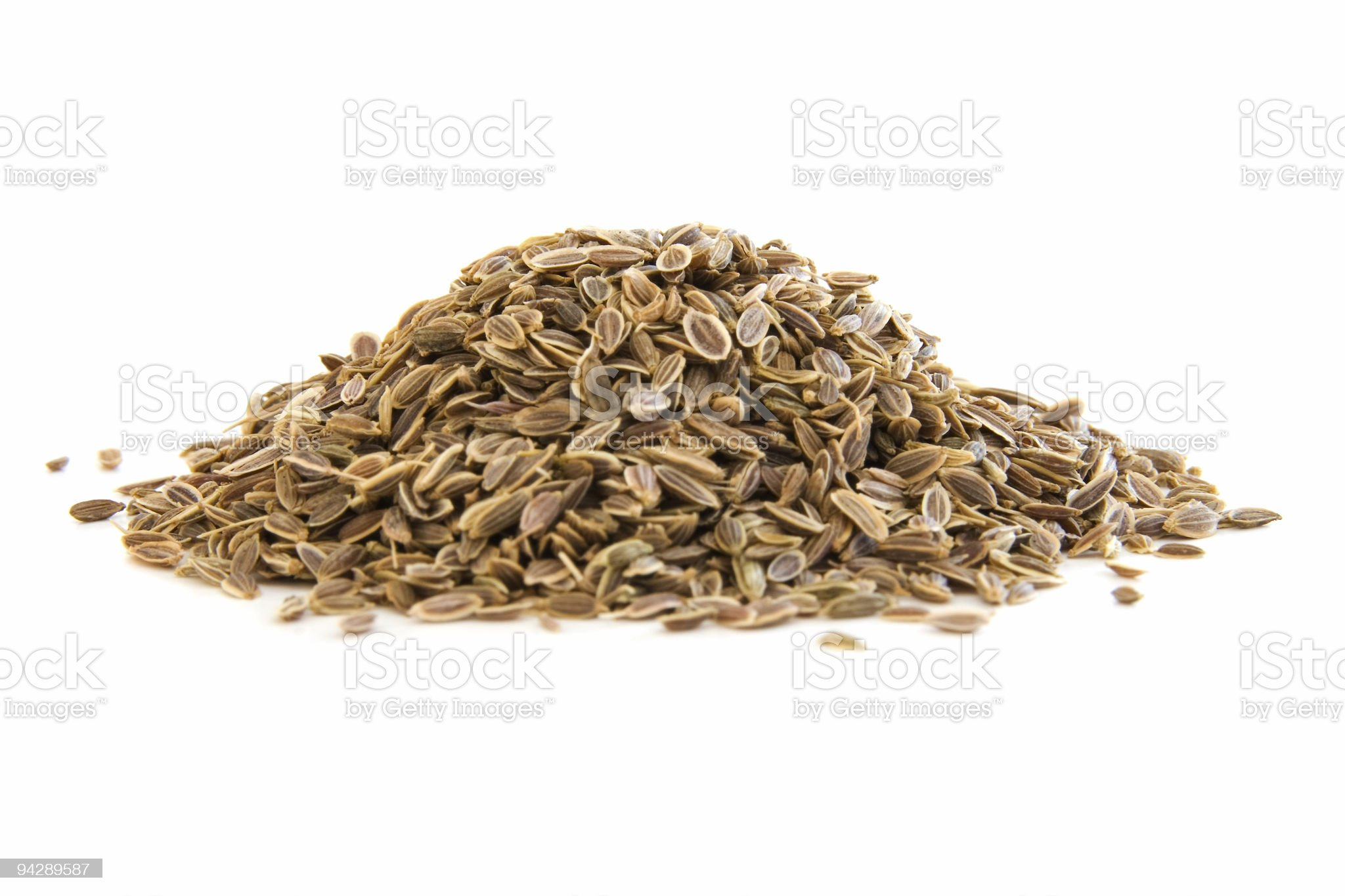 Pile of dill seeds on white royalty-free stock photo