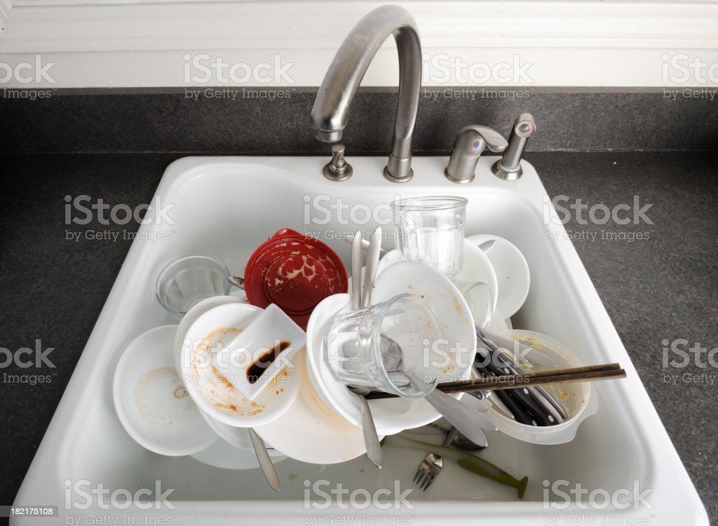 Pile of Dirty Dishes in A Sink stock photo