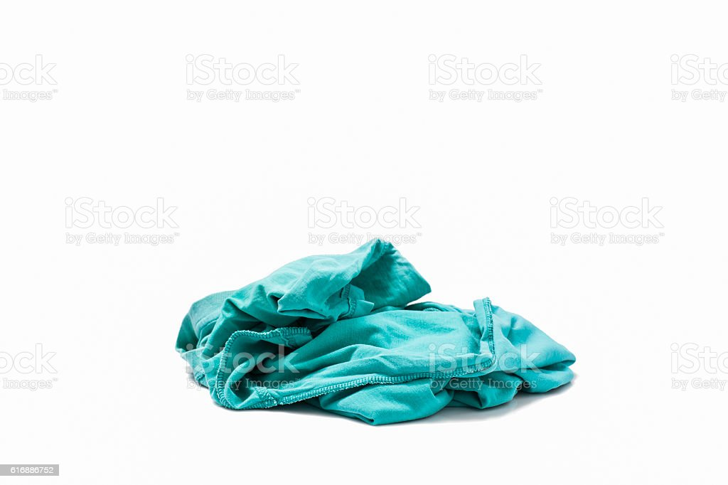 pile of dirty laundry Isolated on white. stock photo