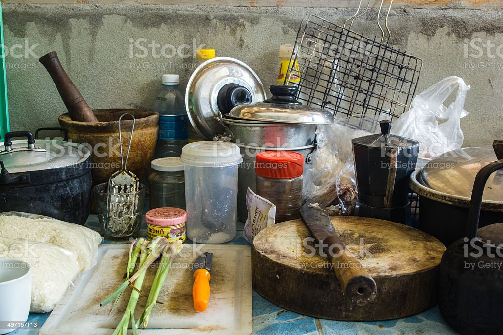 Pile of dirty utensils in the kitchen stock photo