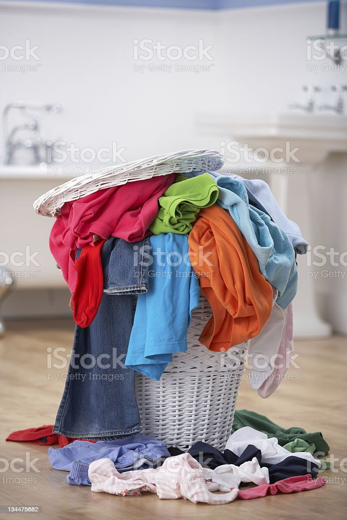 Pile of dirty washing in bathroom stock photo