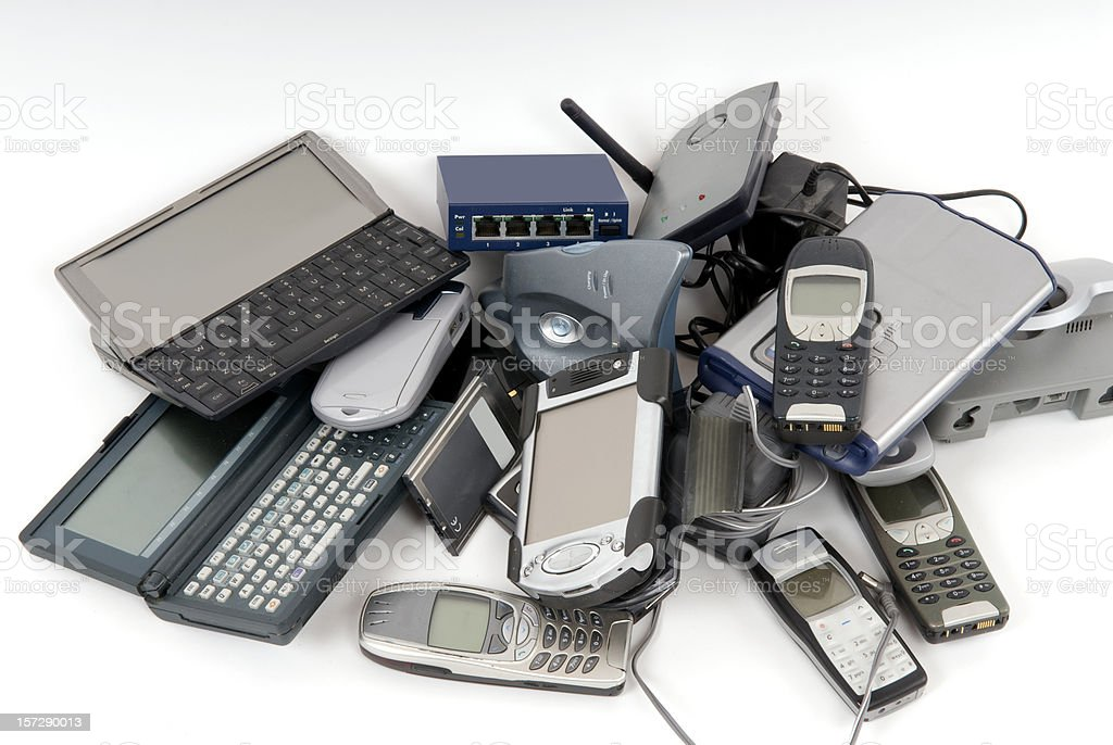Pile of discarded computers and phones stock photo