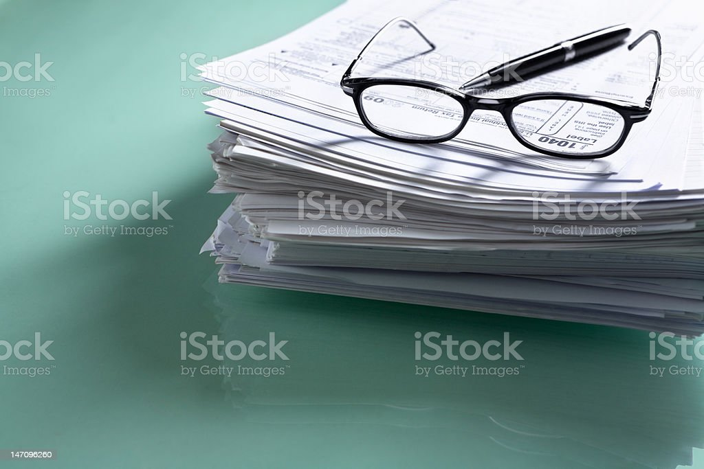 Pile of document with tax form on top stock photo