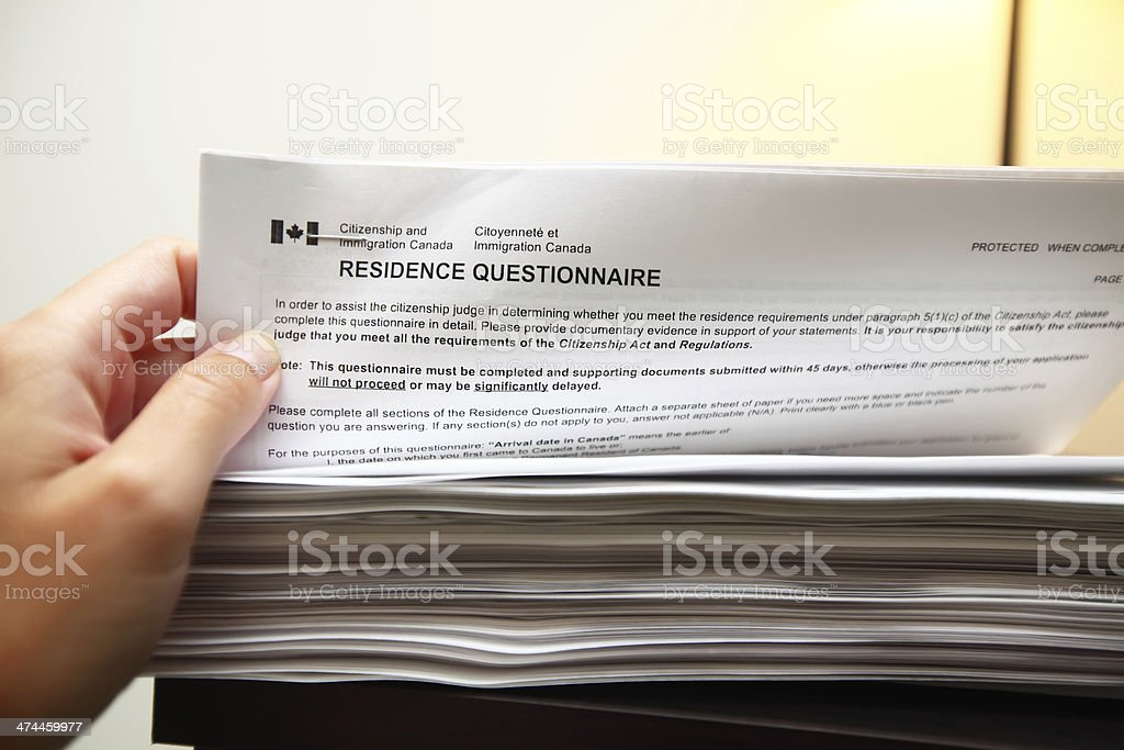 Pile of documents for the residence questionnaire stock photo