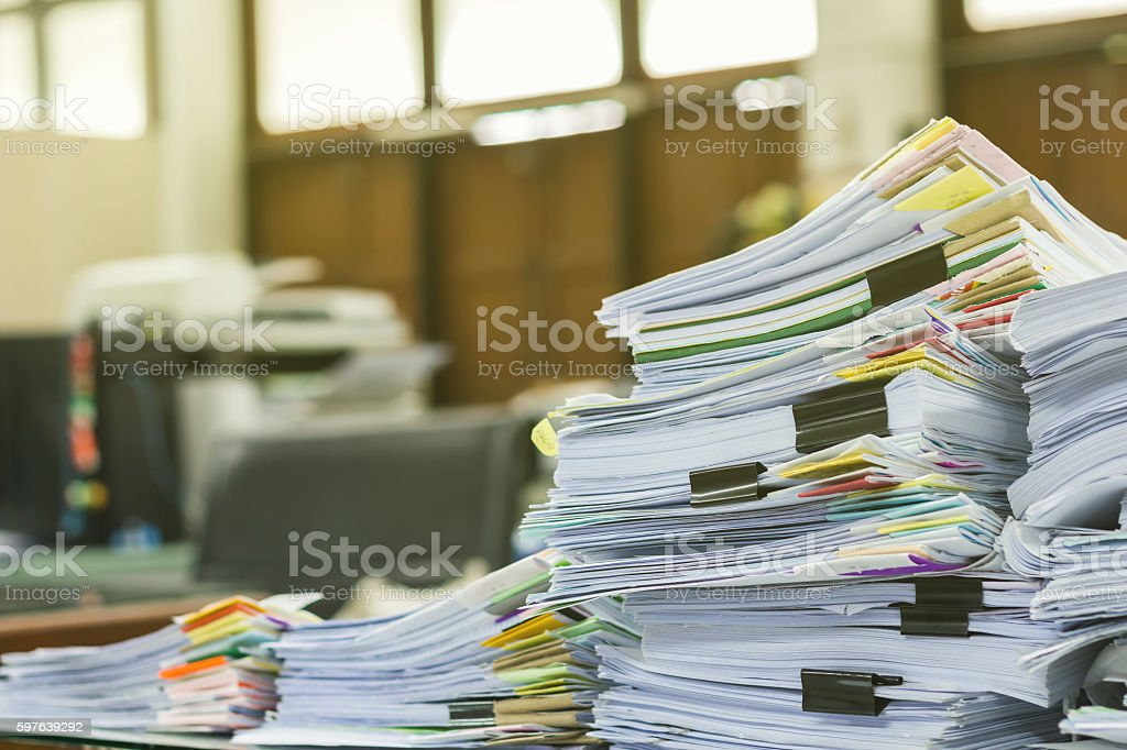 Pile of documents on desk at workplace stock photo