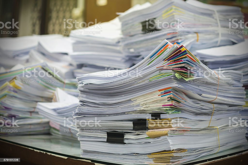 Pile of documents on desk stack up high stock photo