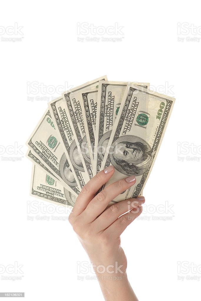 Pile of dollar's banknotes in female hand on white background stock photo