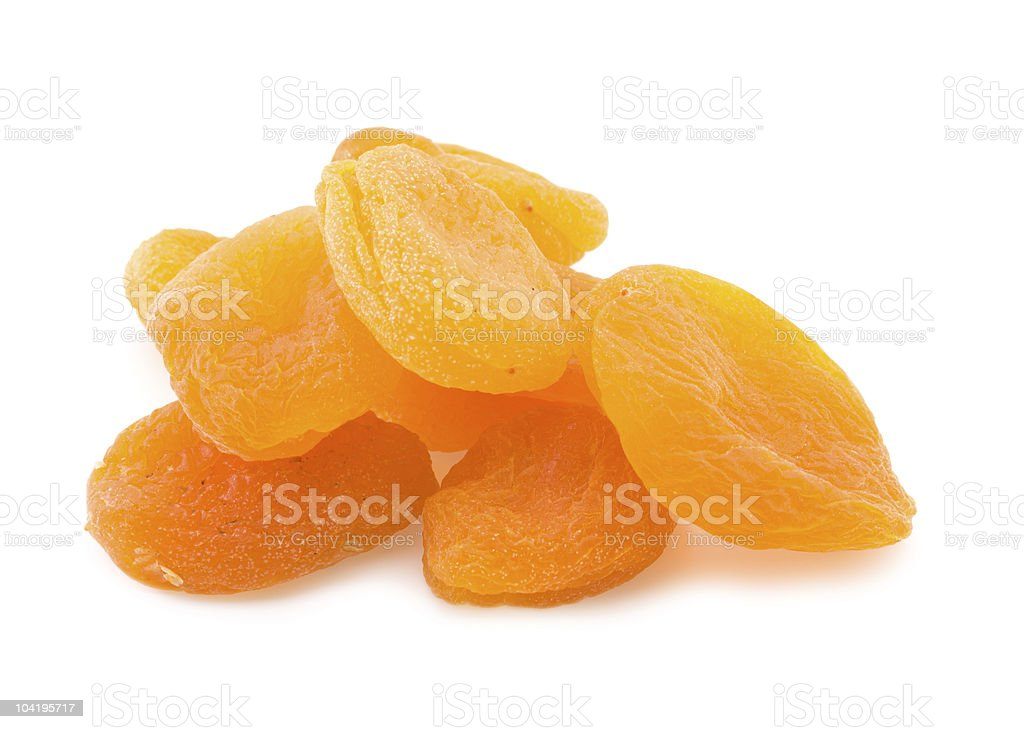 A pile of dried apricots on white stock photo