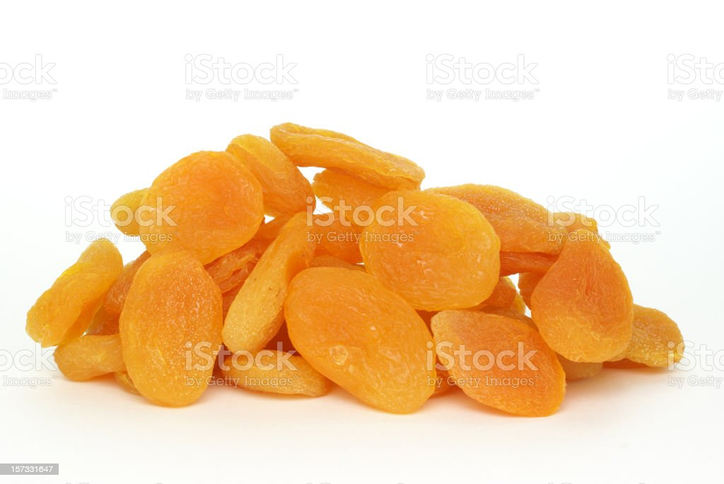 pile of dried apricots on white stock photo